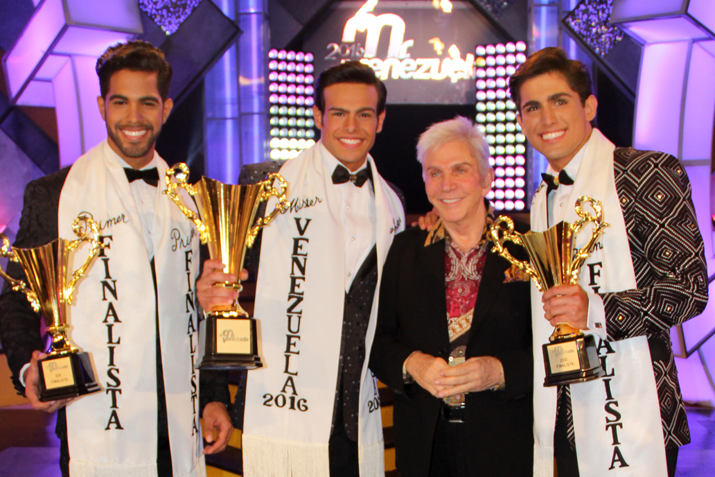 Renato Barabino (center, with Osmel Sousa) and his runner-ups during the Mr. Venezuela competition held in Caracas on May 28th