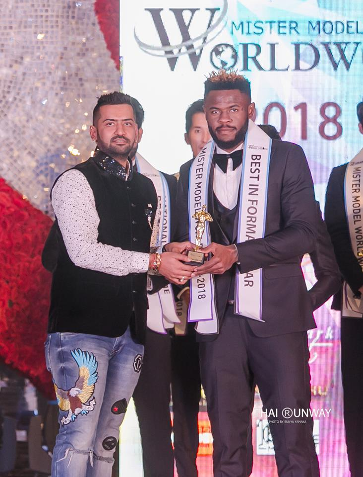 Mr Nigeria, Ogburie Pascal while receiving the Best in Formal Wear award at Mister Model Worldwide 2018 competition.  Picture by Thai Runway / Sunya Yamaka.