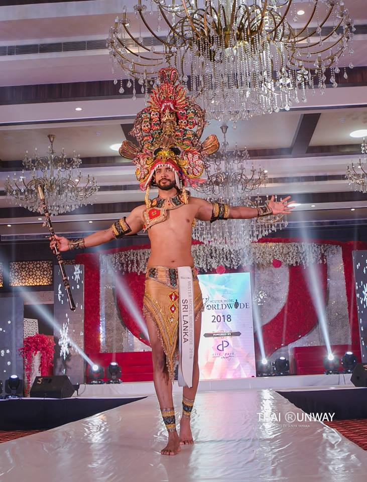 Sajith Perera while walking down the runway during the national costume presentation show of Mister Model Worldwide 2018 competition. Picture by Sunya Yamaka.