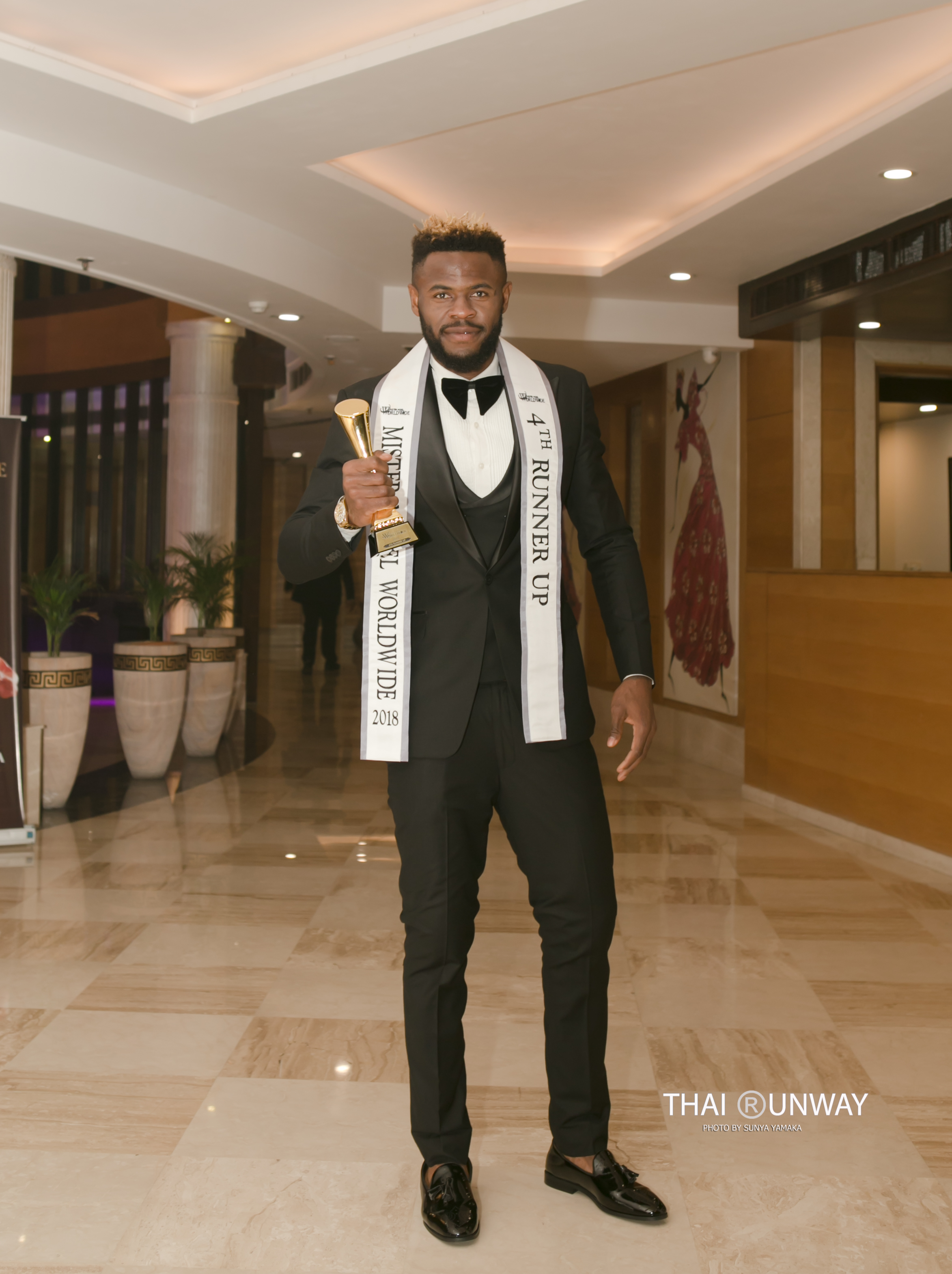 Ogburie Pascal after winning the fourth runner up title and Best in Formal wear award at Mister Model Worldwide 2018 competition.  Picture by Thai Runway / Sunya Yamaka.